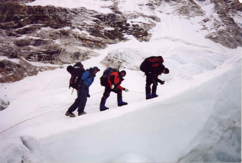 Sherpas carrying heavy loads up Mt. Everest