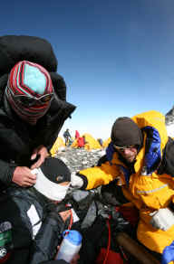 Snow Blindness climber Farouq attended by Tim Rippel